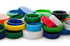 Colored plastic bottle caps for recycling on white Royalty Free Stock Photo