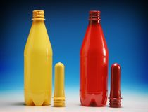 Colored plastic bottles. Over a blue background Royalty Free Stock Image