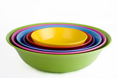 Colored plastic bowls Stock Photos