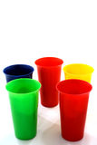 Colored plastic cups. On white stock images