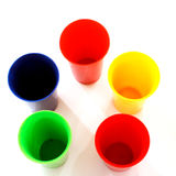 Colored plastic cups. On white royalty free stock image
