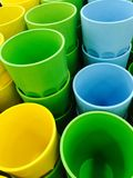 Colored plastic cups. Pack of some sweet organic red peppers royalty free stock photography