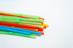 Colored plastic drinking straws on a white background Stock Photography