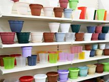 Plastic flower pots on counter in store. Colored plastic flower pots on the counter in the store Royalty Free Stock Photo