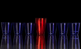 Colored plastic glasses on black Royalty Free Stock Photo