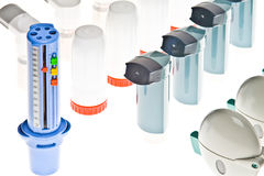 Colored plastic inhalers and PEF. Background of Colored plastic inhalers and PEF Equipment Stock Photo