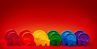Colored plastic plates on red background Royalty Free Stock Image