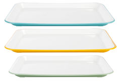 Colored plastic platters on white background Royalty Free Stock Photos