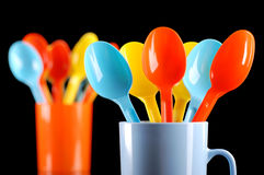 Colored plastic spoons Royalty Free Stock Images