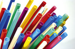 Colored plastic straws. On a neutral background stock image