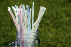 Colored plastic straws Stock Photos