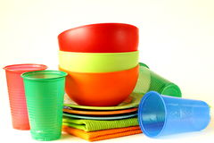 Colored plastic tableware (cups, bowls) Royalty Free Stock Photos