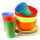 Colored plastic tableware (cups, bowls) Stock Image