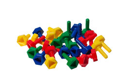 Colored plastic toy screws Stock Photos