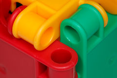 Colored plastic toys closeup Stock Images