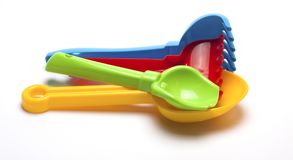 Colored plastic toys for the sandbox on a white background Stock Photography