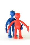 Colored plasticine puppets standing Stock Photo