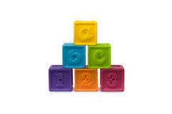 Colored Play Blocks. Pyramid of Colored Play Blocks with letters and numbers Royalty Free Stock Photo