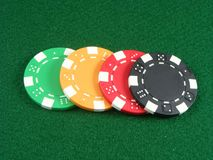 Colored poker chips. A set of colored poker chips on green table royalty free stock photos