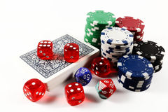 Colored poker chips, card deck and dices isolated. On white background royalty free stock images