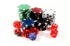 Colored poker chips and dices isolated royalty free stock photos