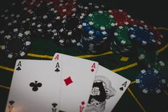Colored poker chips red, blue, green and black. royalty free stock photo