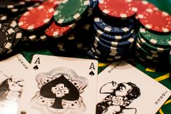 Poker cards and chips of many colors. stock photo
