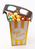 Colored popcorn with 3D glasses Royalty Free Stock Photography