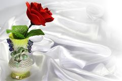 Colored porcelain vase with a red rose Stock Image