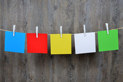 5 colored post it hanging. On a clothesline Royalty Free Stock Photo