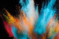 Colored powder explosion on black background. Freeze motion royalty free stock images