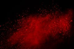 Colored powder explosion. Colore dust splatted. Abstract of red powder explosion on black background. Red powder splatted isolate. Colored cloud. Colored dust royalty free stock photos