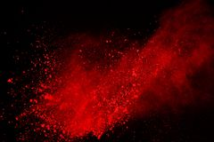Colored powder explosion. Colore dust splatted. Abstract of red powder explosion on black background. Red powder splatted isolate. Colored cloud. Colored dust royalty free stock images