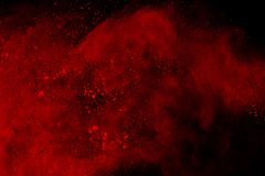 Colored powder explosion. Colore dust splatted. Abstract of red powder explosion on black background. Red powder splatted isolate. Colored cloud. Colored dust stock photography