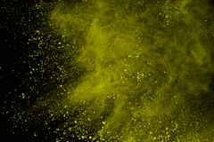Colored powder explosion. Colore dust splatted. Explosion of colored powder isolated on white background. Power or clouds splatted. Freez motion of yellow dust stock photography