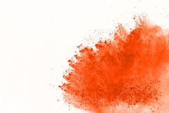 Colored powder explosion. Colore dust splatted. Explosion of colored powder isolated on white background. Power or clouds splatted. Freez motion of orange dust stock image
