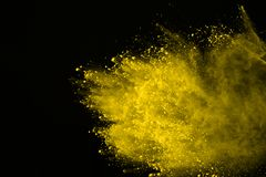 Colored powder explosion. Colore dust splatted. Explosion of colored powder isolated on white background. Power or clouds splatted. Freez motion of yellow dust royalty free stock photography