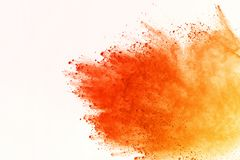 Colored powder explosion. Colore dust splatted. Explosion of colored powder isolated on white background. Power or clouds splatted. Freez motion of orange dust royalty free stock images
