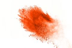 Colored powder explosion. Colore dust splatted. Explosion of colored powder isolated on white background. Power or clouds splatted. Freez motion of orange dust stock images