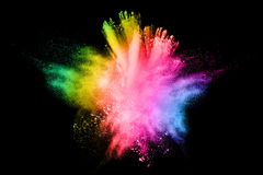 Colored powder explosion. Freeze motion of colored powder explosion  on black background Royalty Free Stock Image