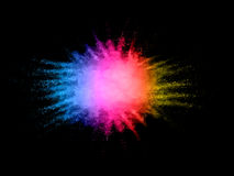 Colored powder explosion stock photography
