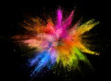 Colored powder explosion isolated on black background. Freeze motion stock image