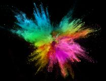 Colored powder explosion isolated on black background. Freeze motion stock photography