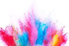 Colored powder explosion on white background. Freeze motion royalty free stock photo