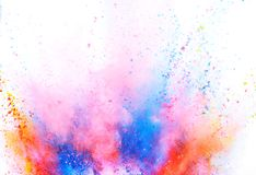 Colored powder explosion on white background. Freeze motion royalty free stock images