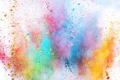 Colored powder explosion on white background. Freeze motion royalty free stock image