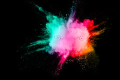 Colored powder splash. Cloud isolated on black background stock images