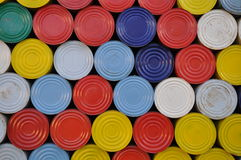 Colored press-in lids of cans Stock Photo