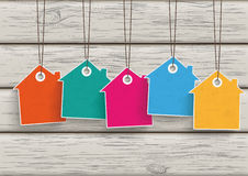 5 Colored Price Sticker House Wood. 5 colored price sticker houses on the wooden background Stock Images