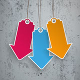 3 Colored Price Stickers Arrows Concrete. Infographic with colored price stickers arrow on the concrete background Stock Image